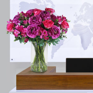 Artificial-Ranunculi-and-Freesia-mix-on-reception-desk.jpg